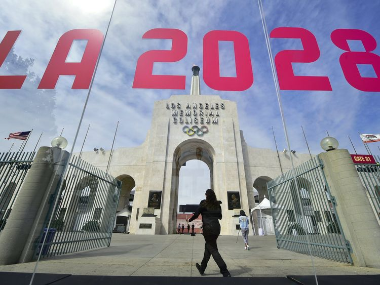 The torch is lit at the Los Angeles Coliseum as the city is officially named as host of the 2028 Summer Olympics