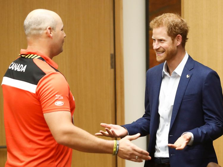 Prince Harry meets veteran and athlete Mike Trauner of Canada ahead of the Invictus Games in Toronto