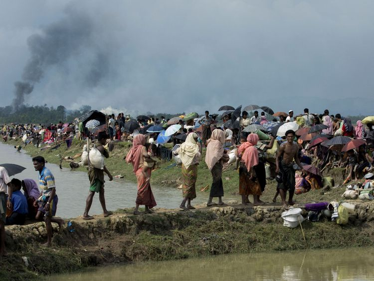 Smoke billows above what is believed to be a burning village in Rakhine state