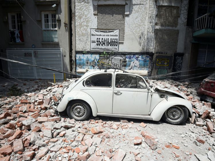 A car crushed by falling debris in Mexico City