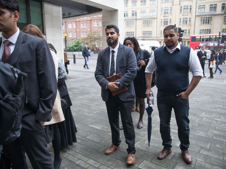 International director of campaign group Cage, Muhammad Rabbani (C) arrives at Westminster Magistrates' Court in London on September 25, 2017, for his trial, after being accused of refusing to reveal his mobile phone password at Heathrow Airport last year. / AFP PHOTO / Daniel LEAL-OLIVAS (Photo credit should read DANIEL LEAL-OLIVAS/AFP/Getty Images)