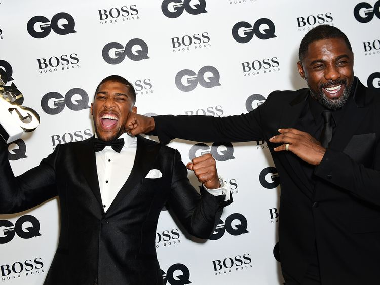 Anthony Joshua (left) with his Best Sportsman award poses with Idris Elba during the GQ Men of the Year Awards