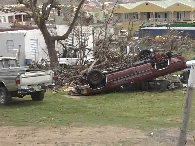 The streets of East End are littered with the debris of houses, yachts, cars and cargo containers