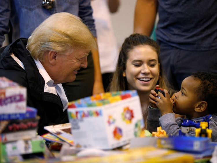 U.S. President Donald Trump visits with survivors of Hurricane Harvey at a relief center in Houston, Texas, U.S., September 2, 2017. REUTERS/Kevin Lamarque