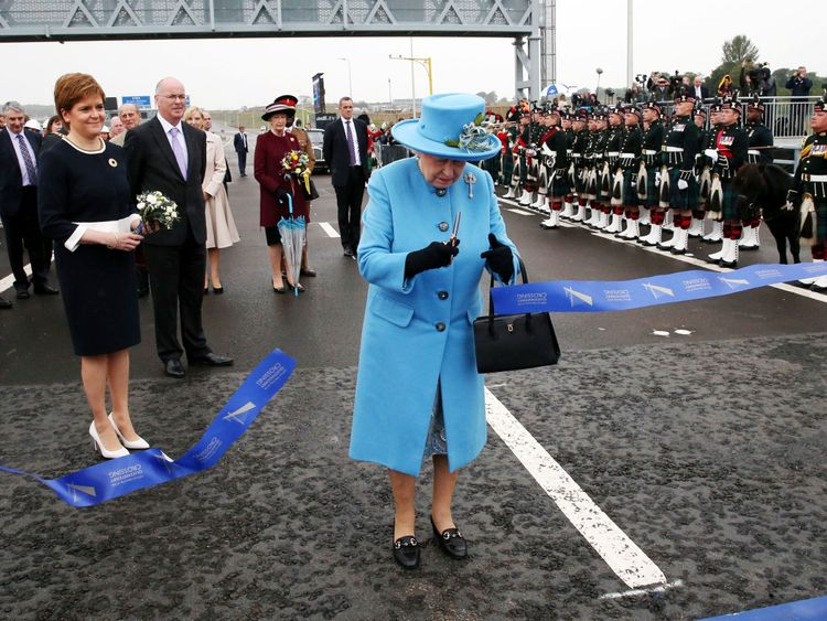 The Queen cuts the tape to open  the Queensferry Crossing over the Firth of Forth near Edinburgh
