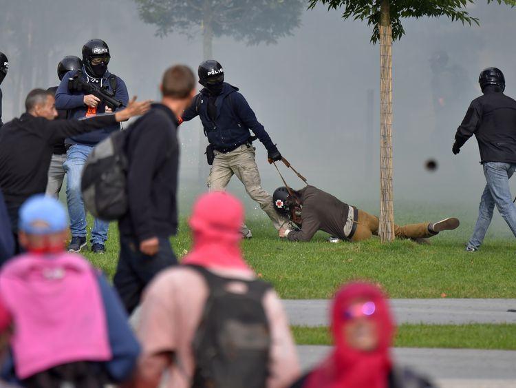 Policemen detain a protester in Nantes