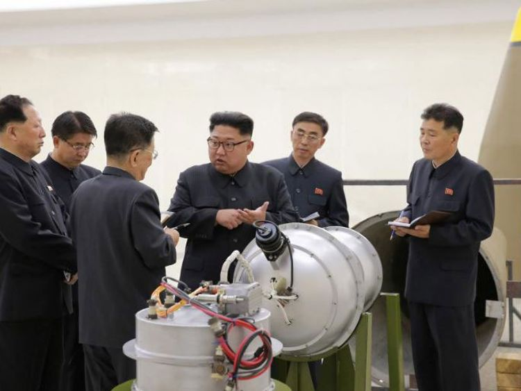 Kim Jong Un examining the purported weapon