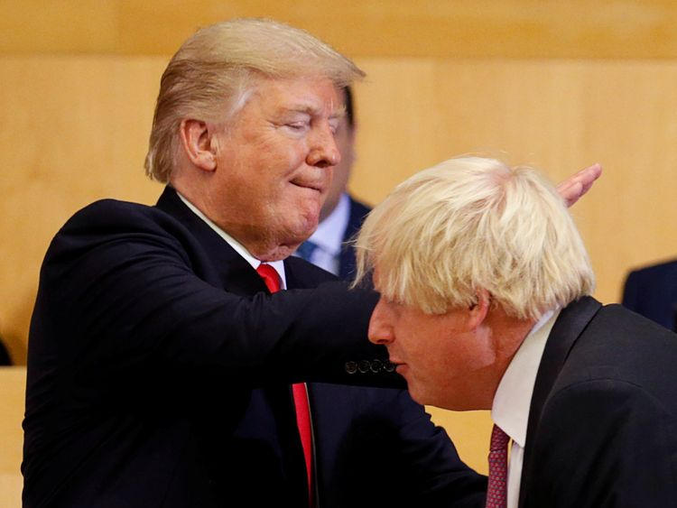 Donald Trump pats Boris Johnson on the back as they participate in a session on reforming the United Nations in New York