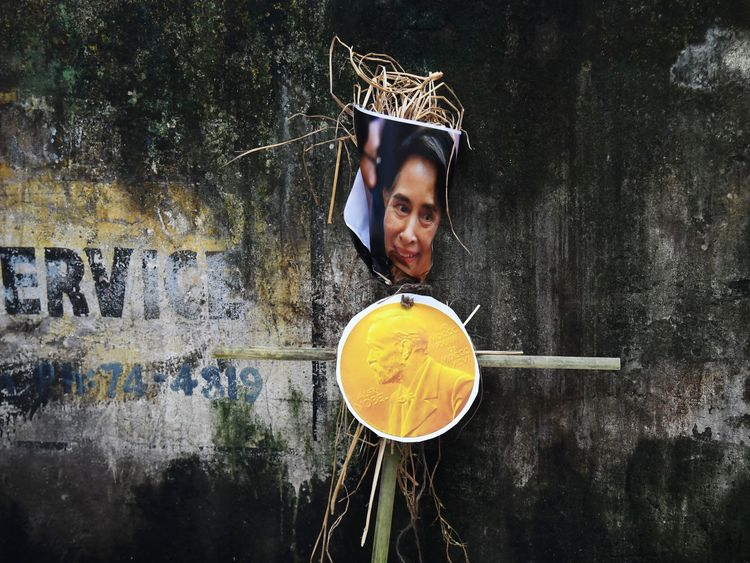 An effigy of Myanmar's civilian leader Aung San Suu Kyi shown with a Nobel prize medal at a protest against violence against Rohingyas