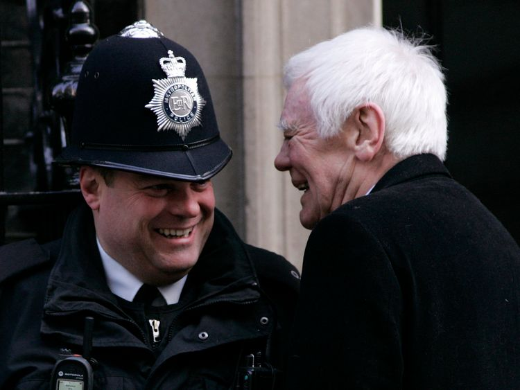 Tony Booth shares a joke with a policeman outside No 10 in 1997