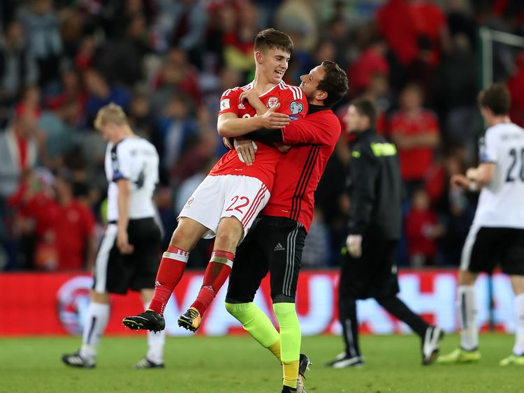 Wales' Ben Woodburn (left) is congratulated by team-mate Danny Ward after the 2018 FIFA World Cup Qualifying, Group D match v Austria in Cardiff