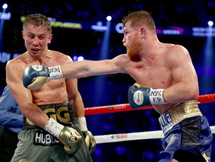 Canelo Alvarez throws a punch at Gennady Golovkin during their WBC, WBA and IBF middleweight championionship bout