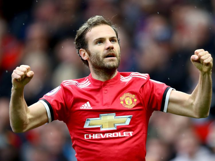 Juan Mata celebrates his early goal for Manchester United