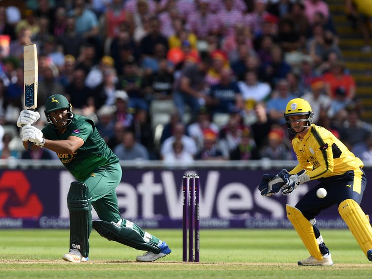 BIRMINGHAM, ENGLAND - SEPTEMBER 02:  Samit Patel of Notts Outlaws hits out ahead of Calvin Dickinson of Hampshire during the NatWest T20 Blast Semi-Final m