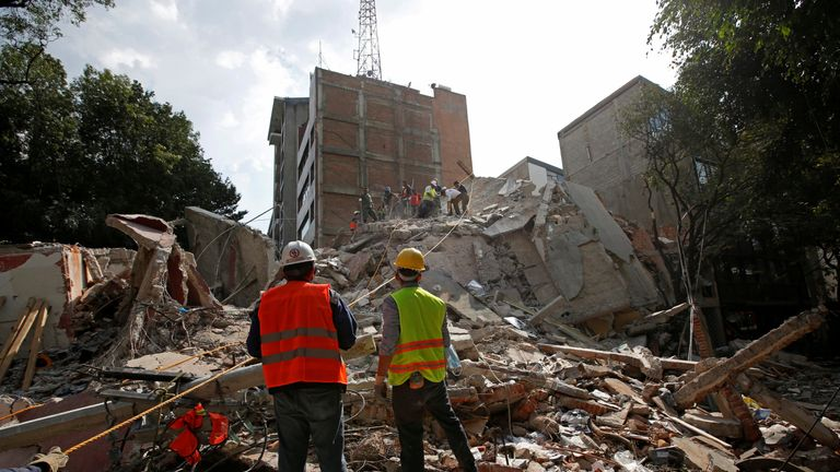 Rescue workers search for people under the rubble