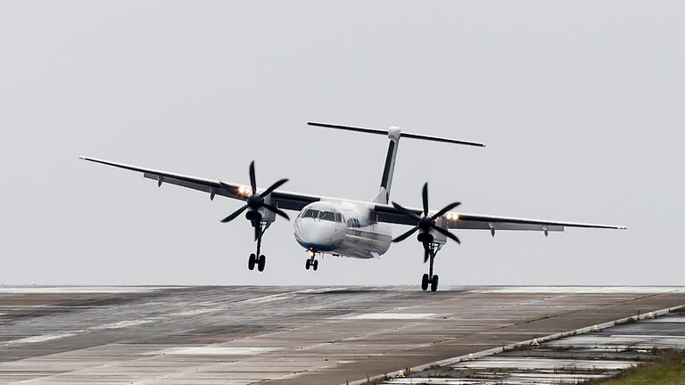 A plane lands at Leeds Bradford Airport as Storm Aileen brought howling gusts to parts of the UK