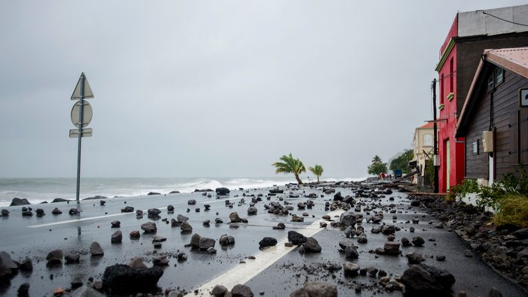 Rocks swept by strong waves onto a road in Le Carbet, on the French Caribbean island of Martinique, after it was hit by Hurricane Maria