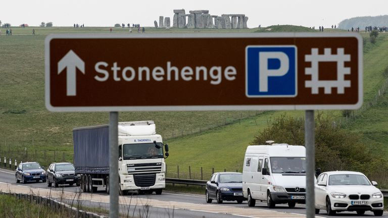 Traffic passes along the busy A303 that runs beside the ancient monument