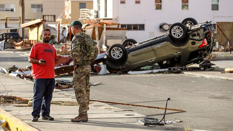 A Royal Marine speaks with a local resident in Tortola, British Virgin Islands