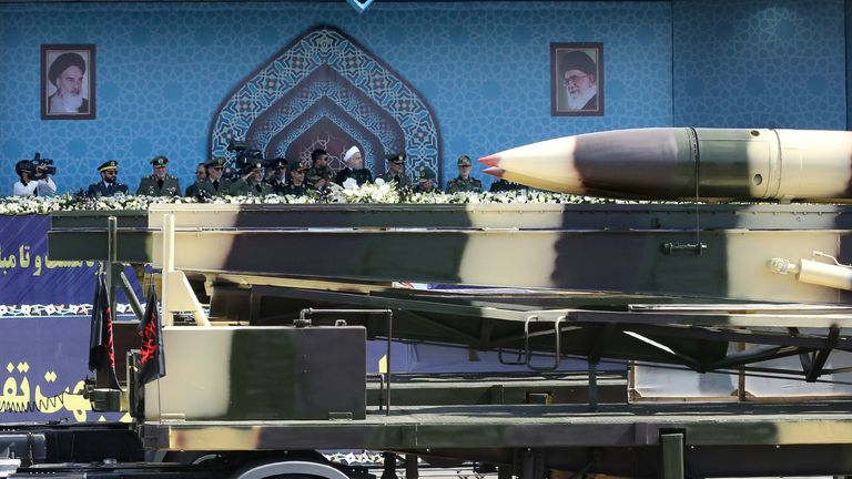 Missiles are displayed during a military parade in Tehran on Friday