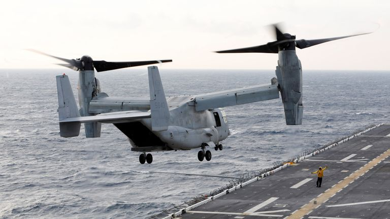 A MV-22 Osprey ferrying Marines bound for islands ravaged by Hurricane Maria takes off at sunrise from the flight deck of the USS Kearsarge