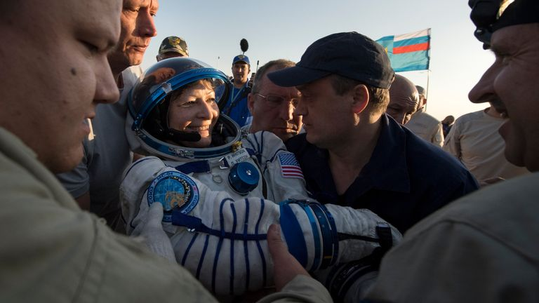 In this handout photo provided by NASA, Expedition 52 NASA astronaut Peggy Whitson is helped out of the Soyuz MS-04 spacecraft