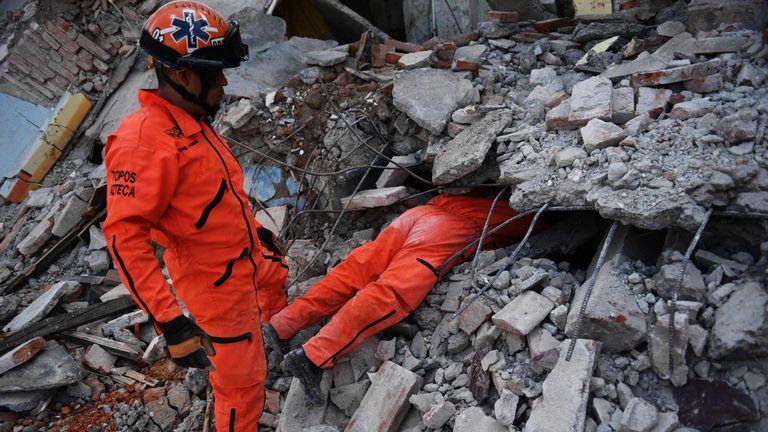 Member of the Moles specialised rescue team search for survivors in Juchitan de Zaragoza