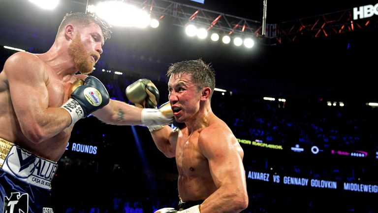 Canelo Alvarez (L) unleashes a left hook against Gennady Golovkin (R) during their WBC, WBA and IBF middleweight championship fight at the T-Mobile Arena on September 16, 2017 in Las Vegas, Nevada. Gennady Golovkin retained his three world middleweight titles, fighting to a draw with Mexican star Canelo Alvarez in a showdown for middleweight supremacy that lived up the hype. / AFP PHOTO / John GURZINSKI (Photo credit should read JOHN GURZINSKI/AFP/Getty Images)
