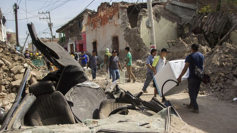 This picture shows of a car crushed by debris from damaged houses in Jojutla de Juarez on September 20, 2017 a day after a strong quake hit central Mexico. More than 200 people died in Mexico after a powerful 7.1 earthquake on Sep 19, causing panic among the megalopolis' 20 million inhabitants on the 32nd anniversary of a devastating 1985 quake. / AFP PHOTO / Enrique Castro Sanchez (Photo credit should read ENRIQUE CASTRO SANCHEZ/AFP/Getty Images)