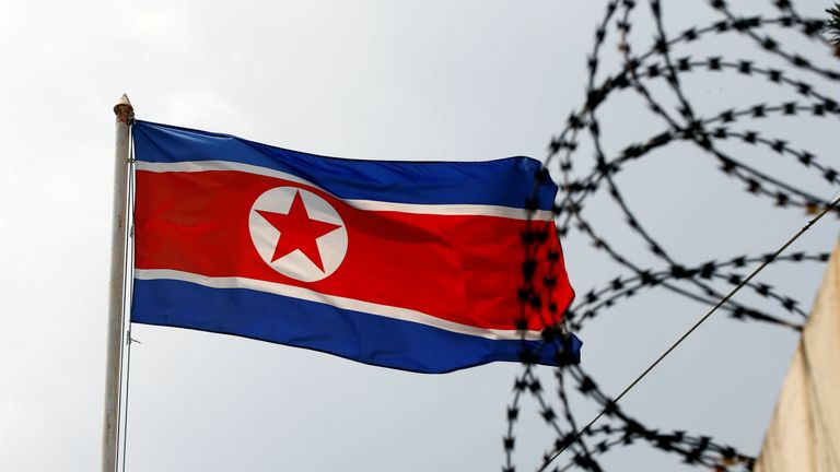 The North Korea flag flutters