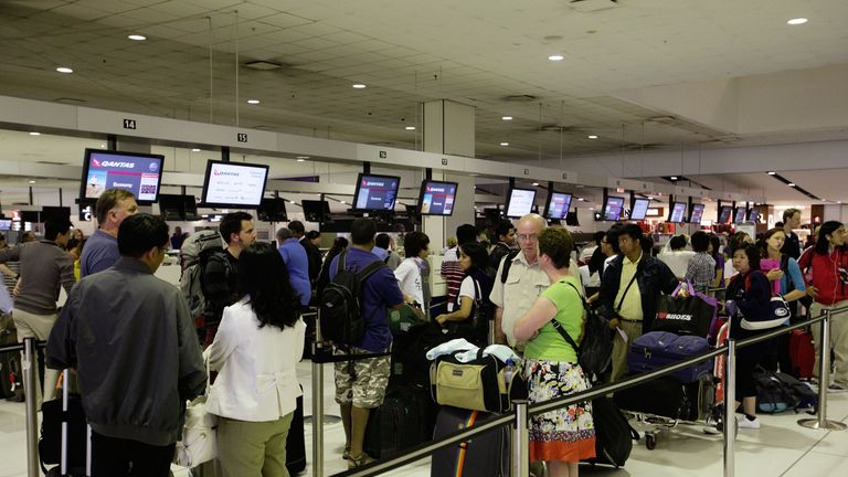 Passengers queue at Sydney International Airport