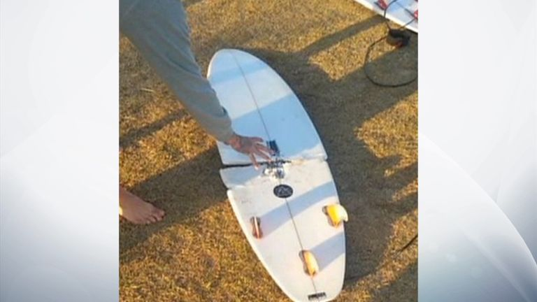 The shark's bite snapped the surfboard in half