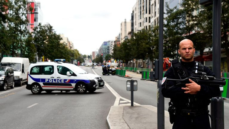 A police officer in a sealed street in the Paris suburb of Villejuif where bomb-making components were found in a flat