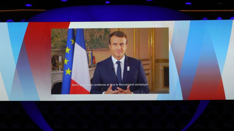 France's President Emmanuel Macron is seen on a screen as he delivers a video speech at the presentation of Paris 2024 at the 131st IOC session in Lima, Peru September 13, 2017. REUTERS/Mariana Bazo