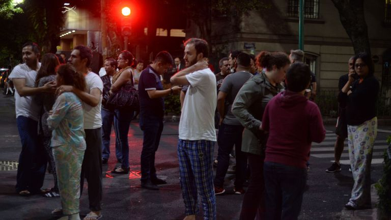 People gathered in the street in Mexico City in their pyjamas
