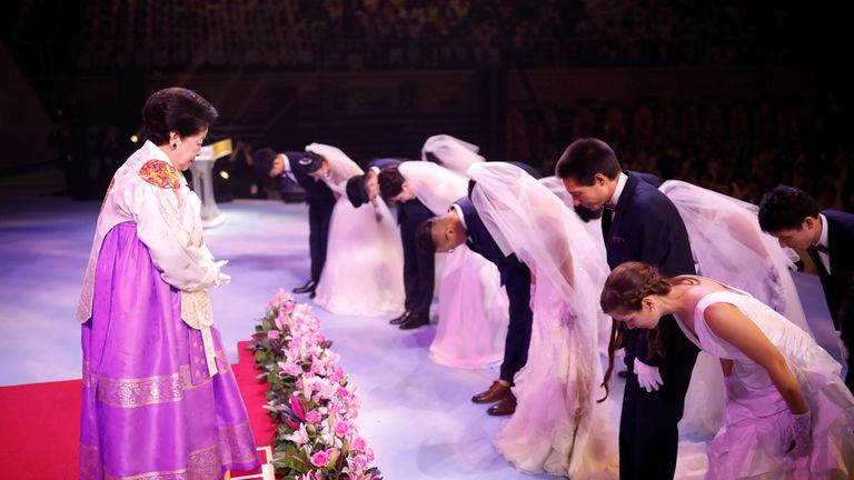 Newlywed couples bow to Han Hak-ja, widow of Evangelist Reverend Moon Sun-myung