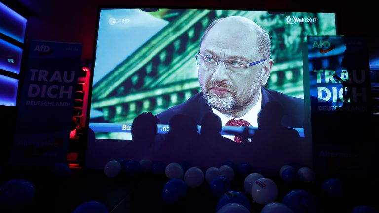 Martin Schulz said taking in refugees had divided the country