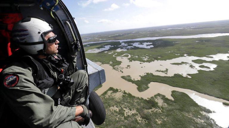 Senior Chief Naval Air Crewman Xipetotec Thorngate searches, during a reconnaissance mission over Key West, Florida