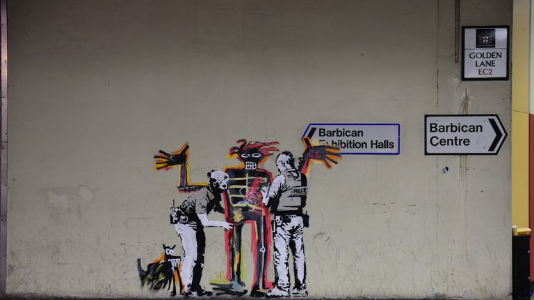 One of two new murals painted by the artist Banksy near the Barbican Centre in London marking the opening of an exhibition by American artist Jean-Michel Basquiat at the arts venue