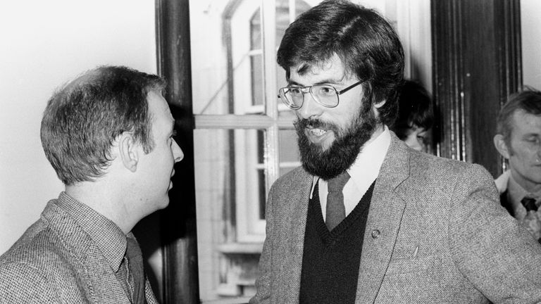 Oct 1982: Adams talks to fellow Sinn Fein candidate Joe Austin at the City Hall in Belfast as they wait for results in the Northern Ireland Assembly elections