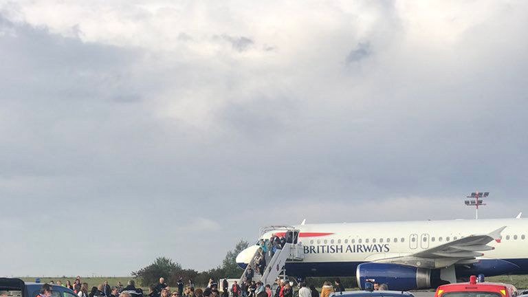 Security personnel surrounded the plane. Pic: James Anderson