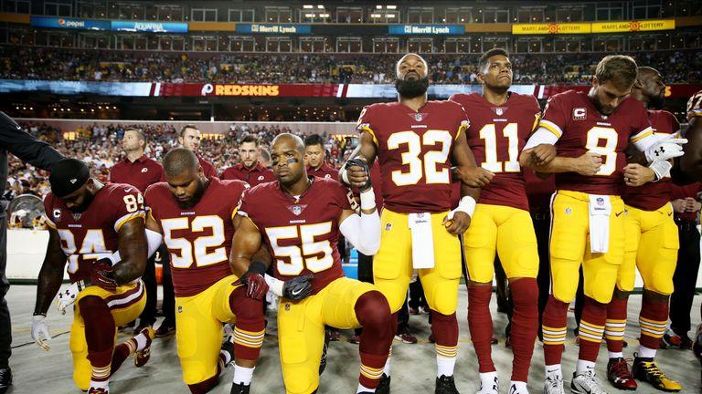 Washington Redskins players kneel during the national anthem