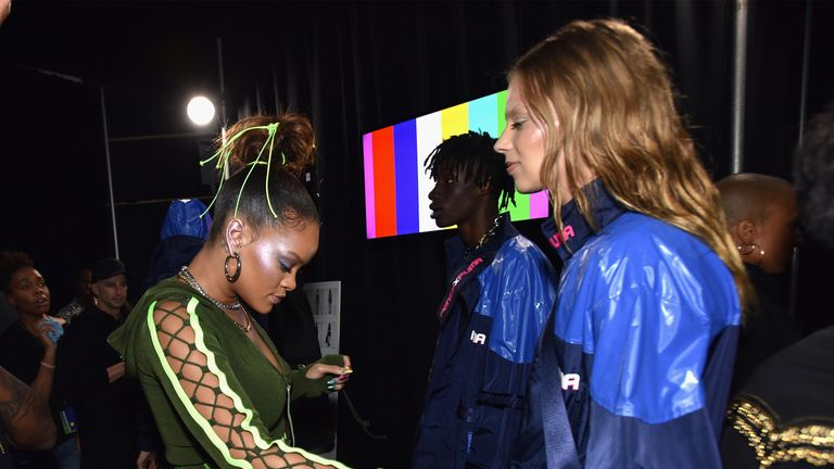RiRi prepares models backstage at the FENTY PUMA by Rihanna Spring/Summer 2018 Collection