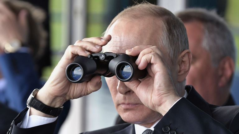 Russian President Vladimir Putin uses binoculars as he visits the MAKS 2017 air show in Zhukovsky, outside Moscow on July 18, 2017