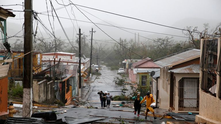 Rescue workers help people after the area was hit by Hurricane Maria in Guayama, Puerto Rico