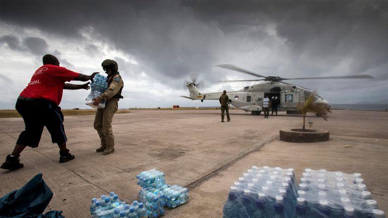 Dutch Army soldiers unload bottles of drinking water at the Sint Maarten International Airport on Saint Martin Island