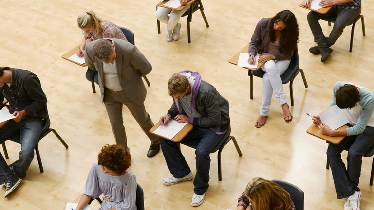 Stock photo: students taking an exam at university