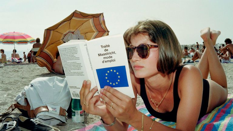 A student of politics reads the 'Maastricht treaty' on a beach in Marseille on August 19, 1992