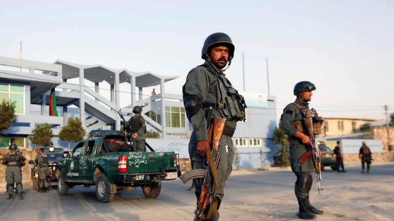 Soldiers stand outside the national cricket stadium in Kabul