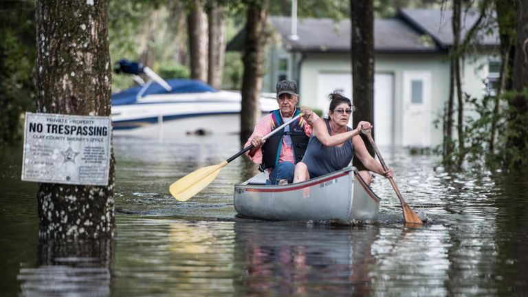 Flood waters from the Black Creek inundate a neighborhood in Middleburg, Florida
